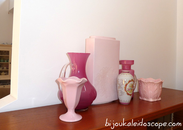 My small collection of pink vases on my foyer cabinet