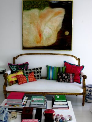 White upholstered French 2 seater with colourful cushions, Anna Spiro's new Brisbane home