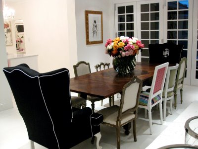 Long dining table with mixed chairs in Anna Spiro's new Brisbane home