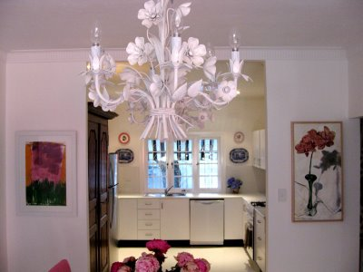 Beautiful white tole flower chandelier in Anna Spiro's new Brisbane home