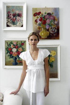 Vibrant flower pictures arranged on a white wall, via James Merrell.