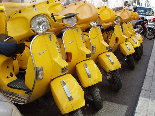Yellow Vespas, via Flickr user: omnipasado