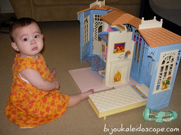 Hannah with her new thrifted Barbie dollhouse