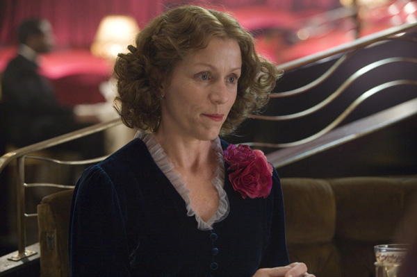 Frances Dormand as Miss Pettigrew in a beautiful velvet dark blue gown, Miss Pettigrew Lives for a Day