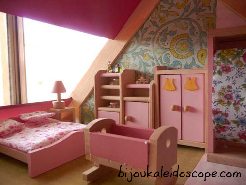 The bedroom with little dress buttons on the dresser.