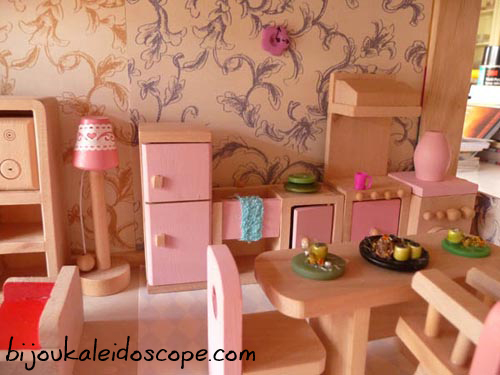 Living dining room with wallpaper, button dishes, button clocks and other bits in our little dollhouse.