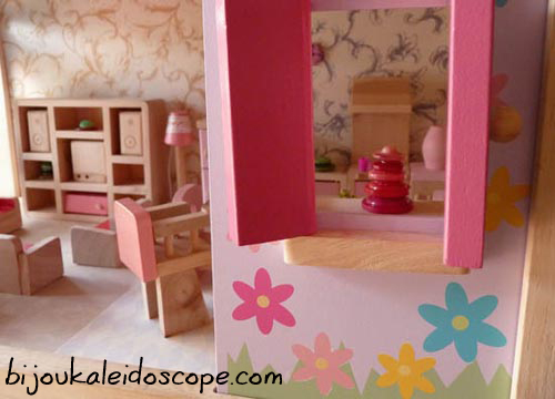 Peeking through our dollhouse