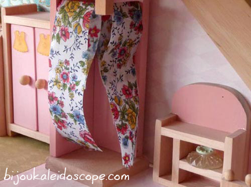Pretty vintage ribbon as shower curtain in our dollhouse