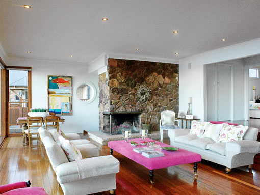 Light airy living room with plenty of whites and a pink coffee table/ottoman, via Australian House and Garden