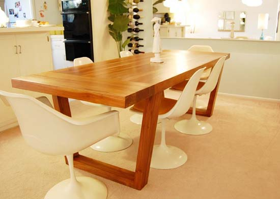 White retro dining chairs with a warm honey dining table
