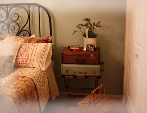 vintage suitcase for bedside table, via A Cottage Industry