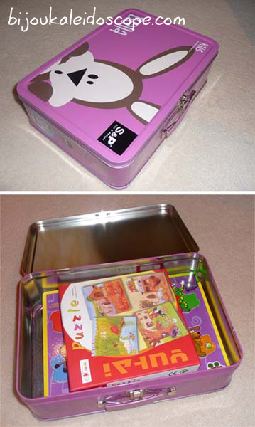 Hannah's metal lunchbox used to store her puzzles