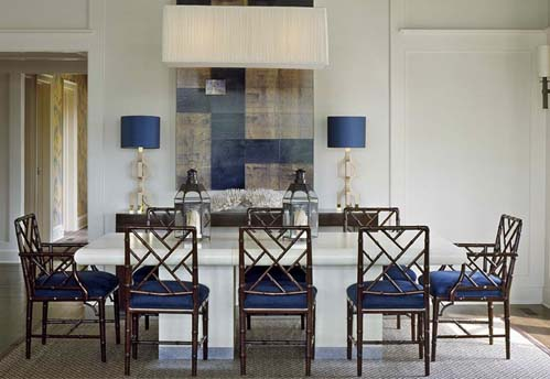 Chinese Chippendale dining chairs upholstered in deep blue with white table