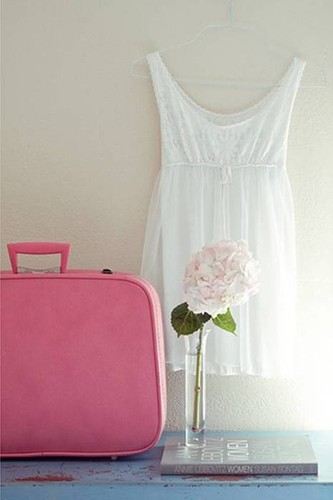 vintage pink suitcase with flowy white dress