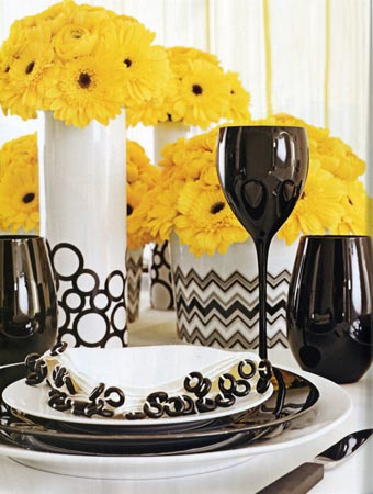 Black and white dinnerware with yellow flowers, via Toast and Tables