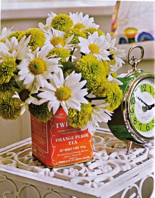 a Twinings tea can used as a vase