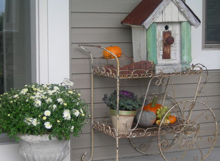 A wire cart on a cute porch, via Junk Market Style