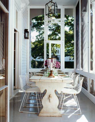 Elegant seating on a side porch, perfect for al fresco meals