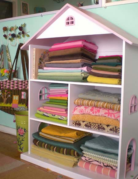 dollhouse used as fabric storage