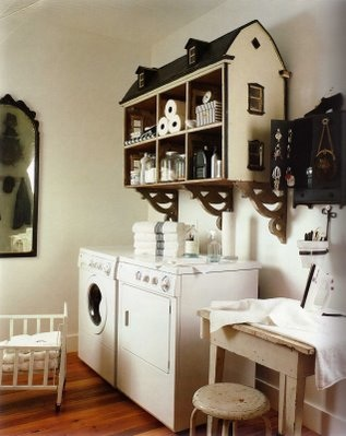 dollhouse used as storage in laundry