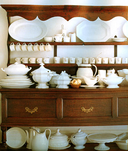 Brown dresser with white porcelain, white French secretaire, via Tessa Evelegh's House Beautiful: Storage Workshop