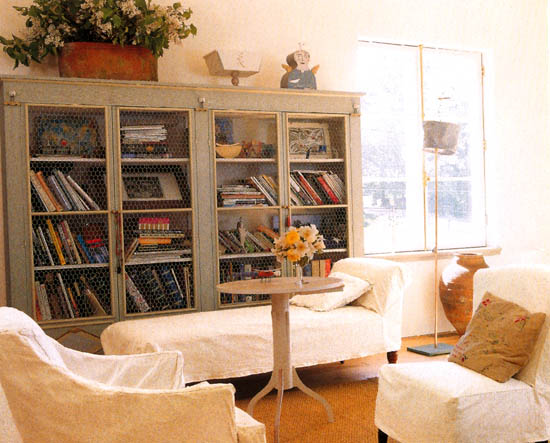 grey bookcase in living area via Tessa Evelegh's House Beautiful: Storage Workshop
