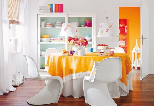 white Panton dining chairs in an all white and orange dining space, via wohn idee