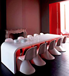 10 white Panton chairs in red and white dining room