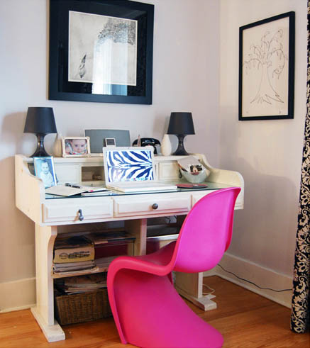 The deep pink Panton chair keeps the study from looking too country