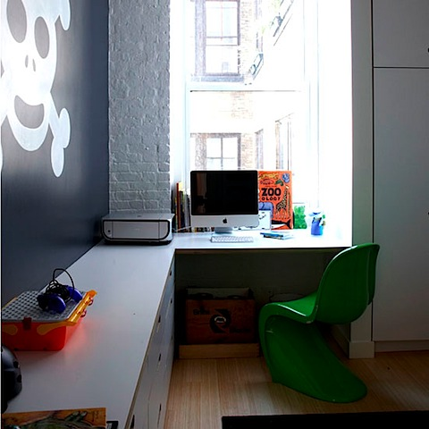 Love the green pop of colour in this study by the Panton chair