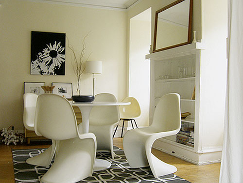 The White Panton chairs blends into the all white scheme