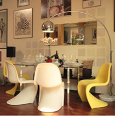 The single yellow Panton chair amongst the whites adds interest