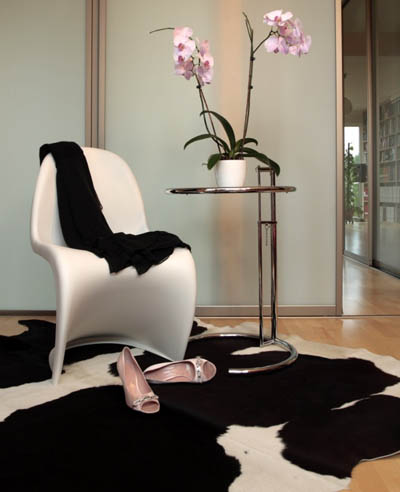 White Panton chair adding style to a white and black space