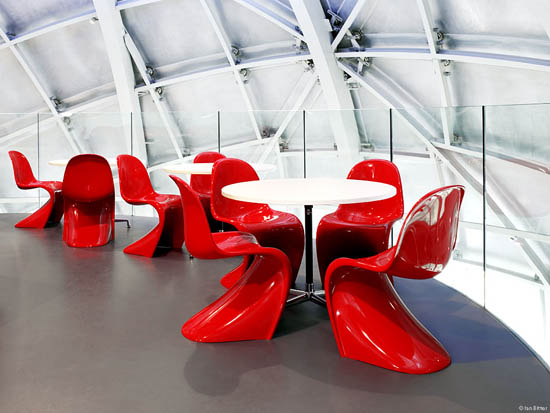 Red Panton chairs pop in this all white space