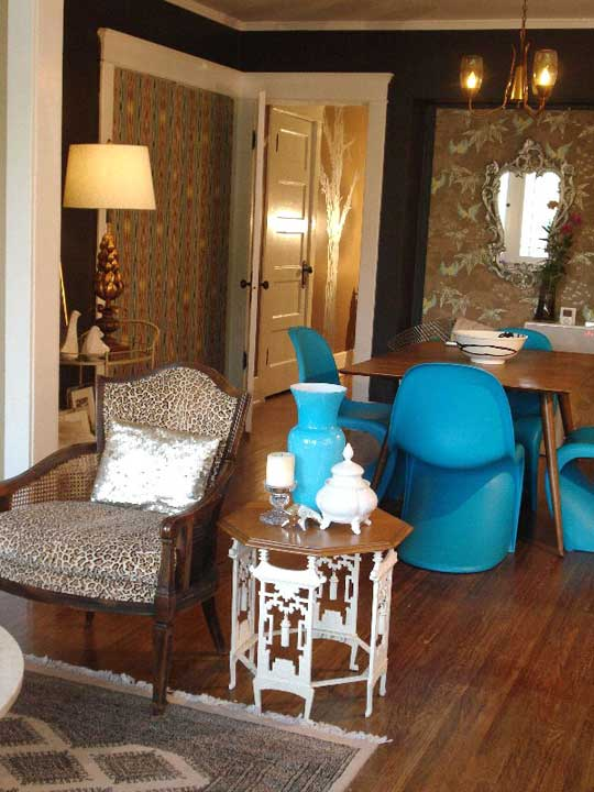 The bright blue Panton chairs pop in this brown toned dining room