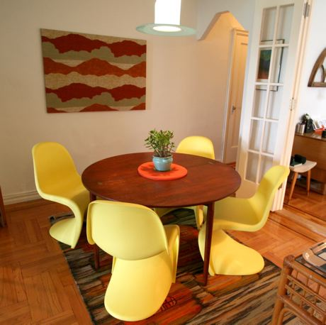 Pale yellow Panton chairs brighten this cozy dining space