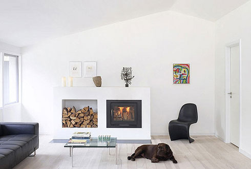 Black Panton chair in this all white living room adds architectural interest