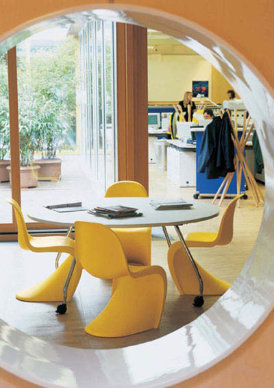 Yellow Panton chairs in this light filled room