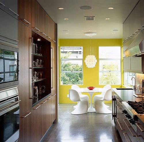 White Panton chairs against the yellow wall makes a statement, via John Lum Architecture
