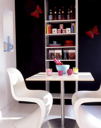 White Panton chairs against black all with red, pink and white accessories