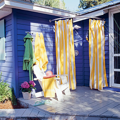 A simple outdoor shower stall, via Coastal Living