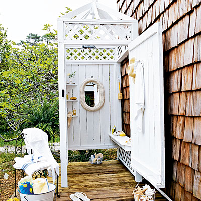 White outdoor shower cubicle, via Coastal Living