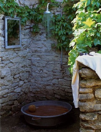 Rustic outdoor shower, much like a well