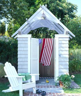 An outdoor shower hut, via Cottage Living