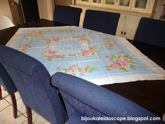 The blue floral tablecloth on its own