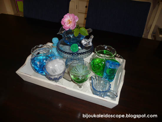 Blue green glassware from around the house on a tray