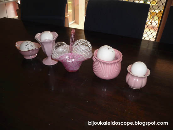 Pink items lined on the dining table