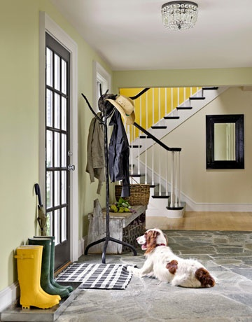 Black and white foyer with yellow stairwell. Glorious!