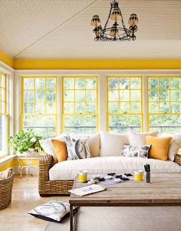 Beautiful sunny room with yellow and white window trim and yellow strip at the top