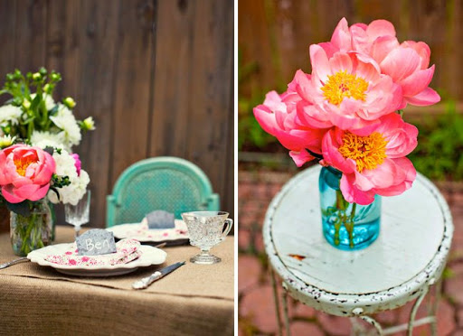 Pink and yellow peonies in blue glass jar, via Green Wedding Shoes